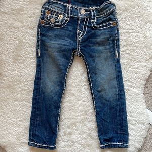 True religion size 2 jeans medium wash with ivory stitching